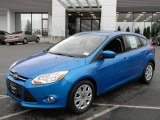 2012 Blue Candy Metallic Ford Focus SE 5-Door #57873693