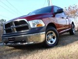 2011 Deep Cherry Red Crystal Pearl Dodge Ram 1500 SLT Quad Cab #58364478