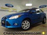 2012 Blue Candy Metallic Ford Focus SE Sedan #58684197