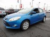 2012 Blue Candy Metallic Ford Focus SE 5-Door #60045034