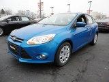 2012 Blue Candy Metallic Ford Focus SE 5-Door #60045028