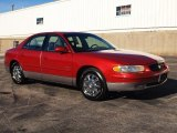 Dark Carmine Red Metallic Buick Regal in 1999