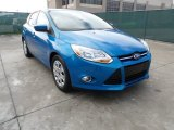 2012 Blue Candy Metallic Ford Focus SE 5-Door #60973420
