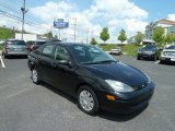 2004 Pitch Black Ford Focus SE Sedan #64663555
