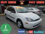 2004 Cloud 9 White Ford Focus LX Sedan #65138478