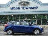 2012 Blue Candy Metallic Ford Focus SE 5-Door #65138139