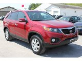 2011 Spicy Red Kia Sorento LX #65229211