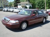 Autumn Red Metallic Lincoln Town Car in 2003