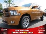 2012 Tequila Sunrise Pearl Dodge Ram 1500 Sport Quad Cab #68152557