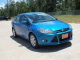 2012 Blue Candy Metallic Ford Focus SE Sedan #68153281