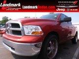 2009 Sunburst Orange Pearl Dodge Ram 1500 SLT Quad Cab #69404126