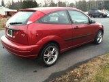 Sangria Red Metallic Ford Focus in 2003