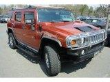 Sunset Orange Metallic Hummer H2 in 2003
