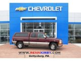 2000 Dark Carmine Red Metallic Chevrolet Silverado 1500 LS Extended Cab 4x4 #79872476