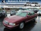 Dark Cherry Red Metallic Cadillac DeVille in 1997