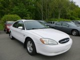 Vibrant White Ford Taurus in 2001
