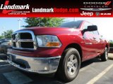 2012 Deep Cherry Red Crystal Pearl Dodge Ram 1500 SLT Quad Cab #82215596