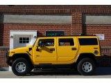 2003 Yellow Hummer H2 SUV #86559485