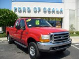 1999 Vermillion Red Ford F350 Super Duty Lariat SuperCab 4x4 #8922189