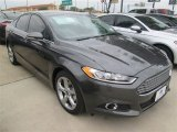 2015 Magnetic Metallic Ford Fusion SE #98815414