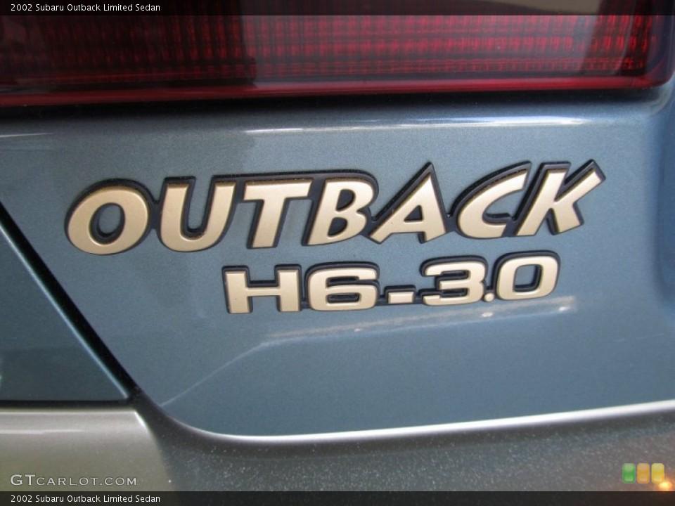 2002 Subaru Outback Badges and Logos