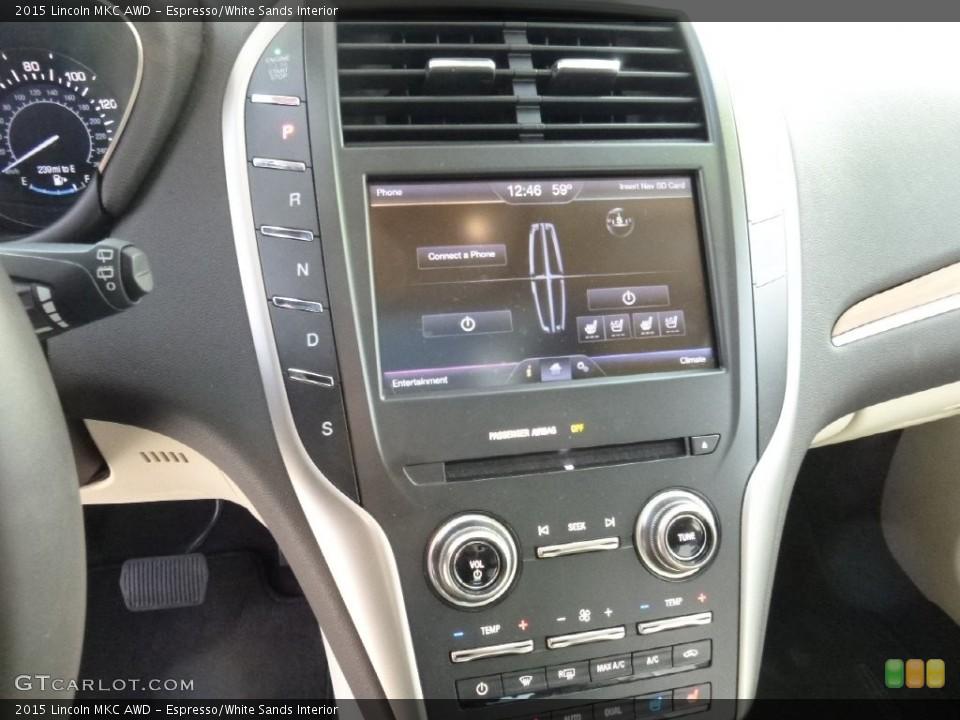 Espresso/White Sands Interior Controls for the 2015 Lincoln MKC AWD #108908186