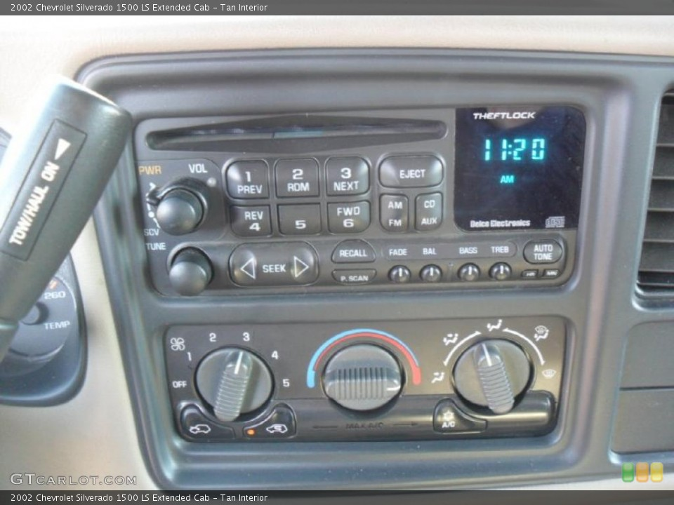 Tan Interior Controls for the 2002 Chevrolet Silverado 1500 LS Extended Cab #44250744