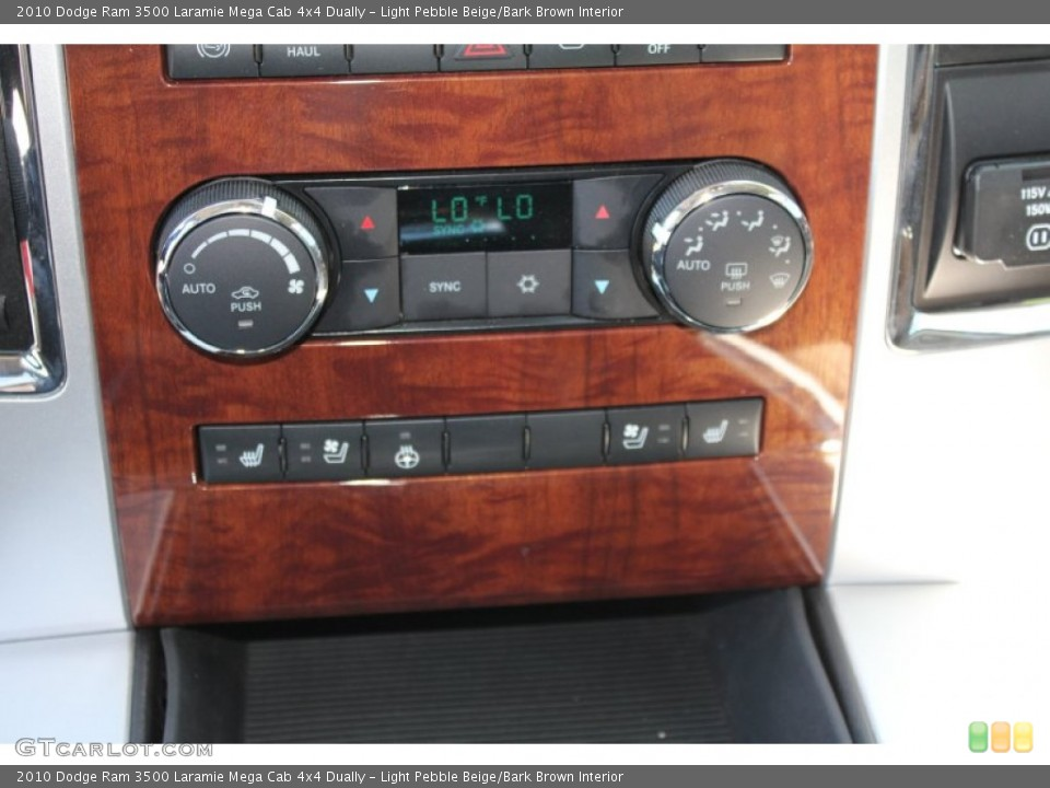Light Pebble Beige/Bark Brown Interior Controls for the 2010 Dodge Ram 3500 Laramie Mega Cab 4x4 Dually #51700798