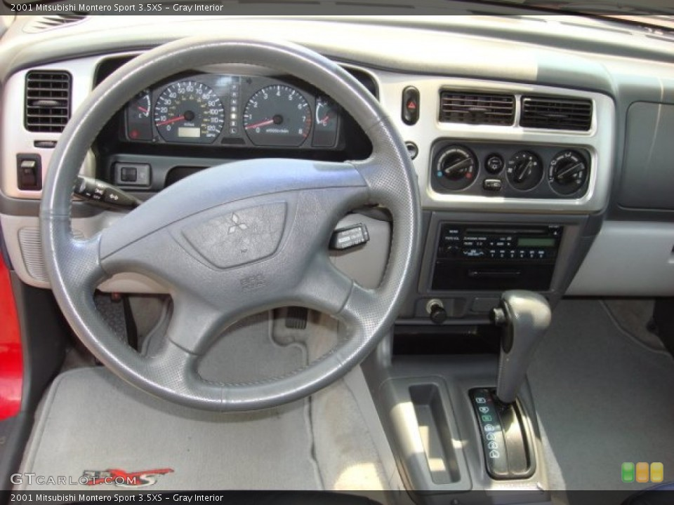 gray interior dashboard for the 2001 mitsubishi montero sport 35xs 52107737 - Mitsubishi Montero 2003 Interior