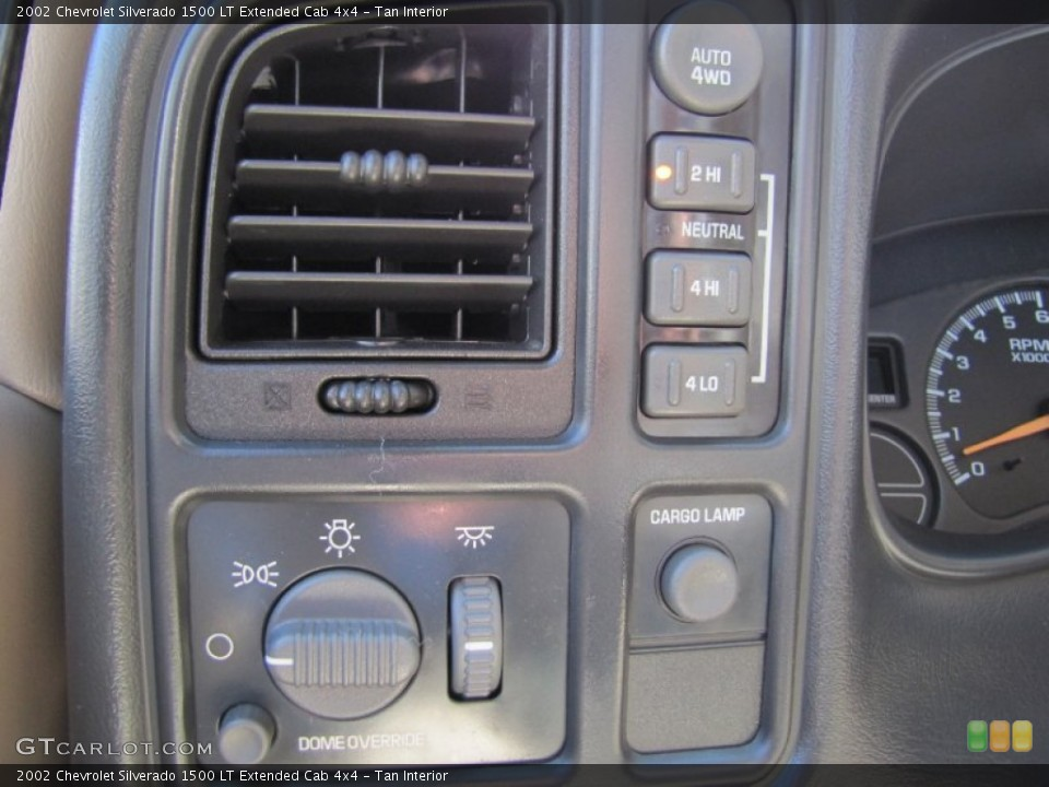 Tan Interior Controls for the 2002 Chevrolet Silverado 1500 LT Extended Cab 4x4 #52936617