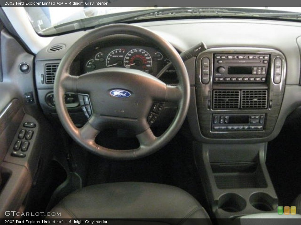 Midnight Grey Interior Dashboard for the 2002 Ford Explorer Limited 4x4 #53650566
