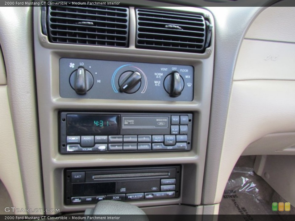 Medium Parchment Interior Controls for the 2000 Ford Mustang GT Convertible #66821088
