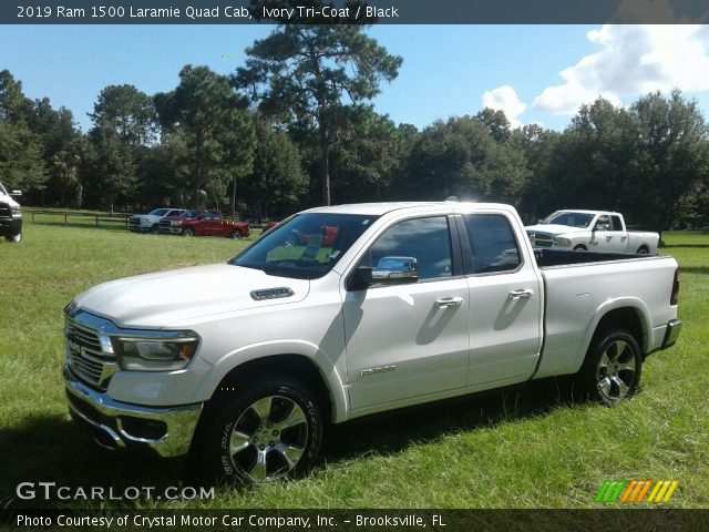 2019 Ram 1500 Laramie Quad Cab in Ivory Tri–Coat