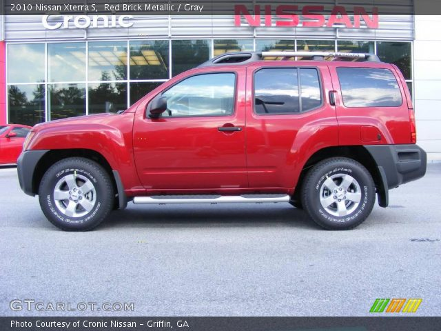 red brick metallic 2010 nissan xterra s gray interior vehicle archive 17048461. Black Bedroom Furniture Sets. Home Design Ideas