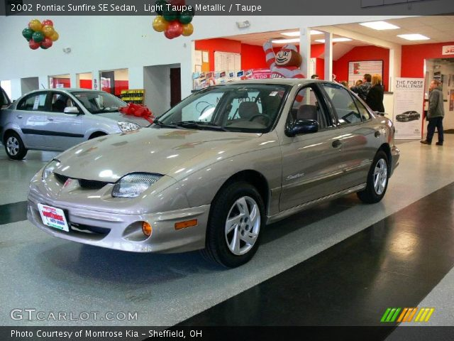 light taupe metallic 2002 pontiac sunfire se sedan. Black Bedroom Furniture Sets. Home Design Ideas