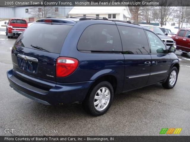 Midnight blue pearl 2005 chrysler town country touring for Stone s town country motors
