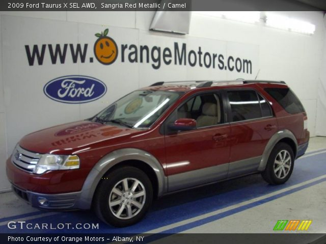 sangria red metallic 2009 ford taurus x sel awd camel interior vehicle. Black Bedroom Furniture Sets. Home Design Ideas