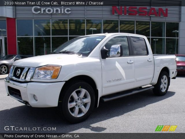 blizzard white 2010 nissan titan le crew cab charcoal interior vehicle. Black Bedroom Furniture Sets. Home Design Ideas