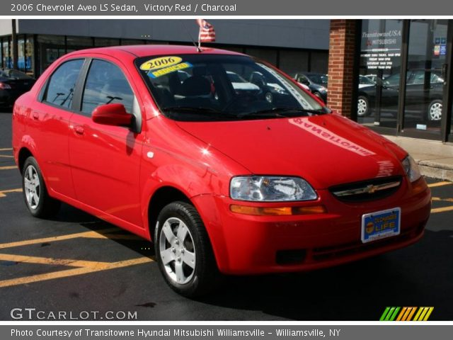 victory red 2006 chevrolet aveo ls sedan charcoal. Black Bedroom Furniture Sets. Home Design Ideas
