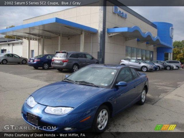 blue 2002 saturn s series sc2 coupe gray interior vehicle archive 38170284. Black Bedroom Furniture Sets. Home Design Ideas