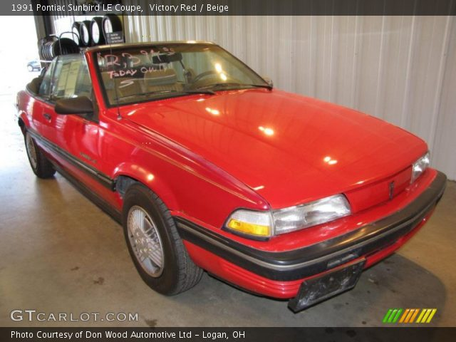 Victory Red 1991 Pontiac Sunbird Le Coupe Beige
