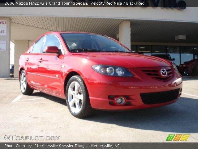 velocity red mica 2006 mazda mazda3 s grand touring sedan black red interior. Black Bedroom Furniture Sets. Home Design Ideas