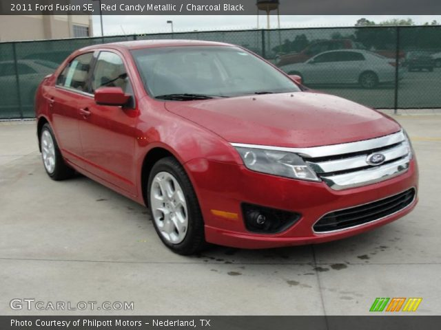 red candy metallic 2011 ford fusion se charcoal black interior. Black Bedroom Furniture Sets. Home Design Ideas