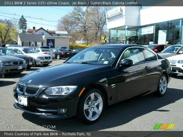 jet black 2011 bmw 3 series 335i xdrive coupe oyster black dakota leather interior. Black Bedroom Furniture Sets. Home Design Ideas