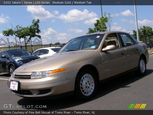 medium gold 2002 saturn l series l100 sedan medium tan interior vehicle. Black Bedroom Furniture Sets. Home Design Ideas