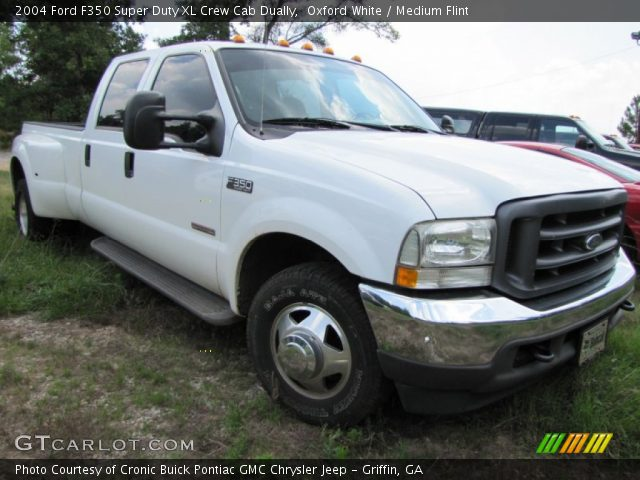 2004 Ford F350 Super Duty XL Crew Cab Dually in Oxford White. Click to