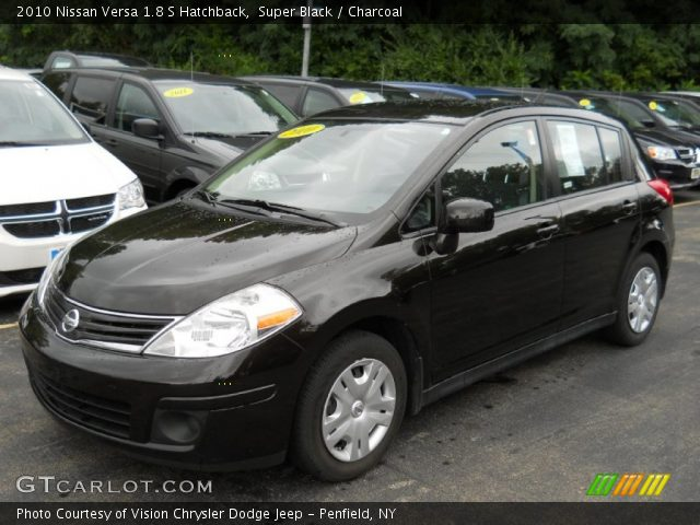 super black 2010 nissan versa 1 8 s hatchback charcoal. Black Bedroom Furniture Sets. Home Design Ideas