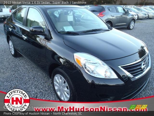 super black 2012 nissan versa 1 6 sv sedan sandstone interior vehicle. Black Bedroom Furniture Sets. Home Design Ideas
