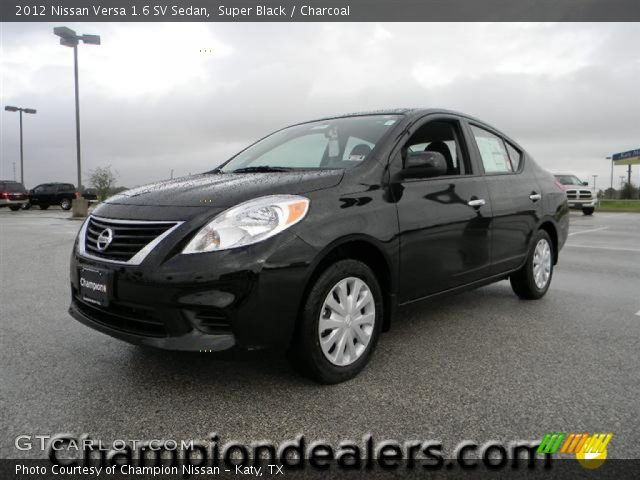 super black 2012 nissan versa 1 6 sv sedan charcoal interior vehicle. Black Bedroom Furniture Sets. Home Design Ideas