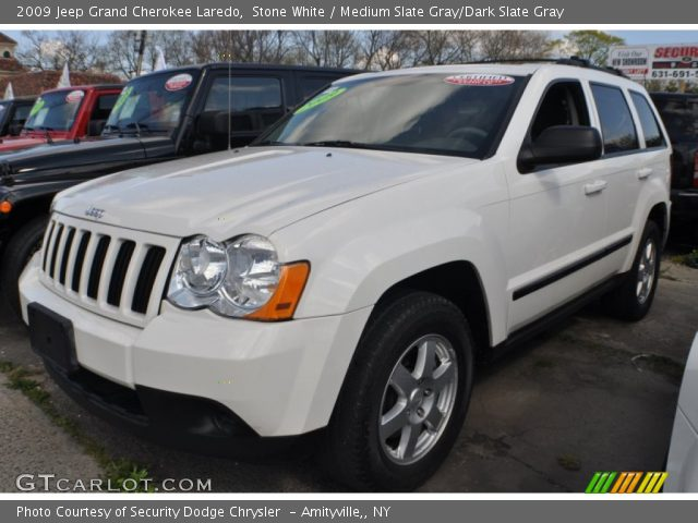 stone white 2009 jeep grand cherokee laredo medium slate gray dark slate gray interior. Black Bedroom Furniture Sets. Home Design Ideas